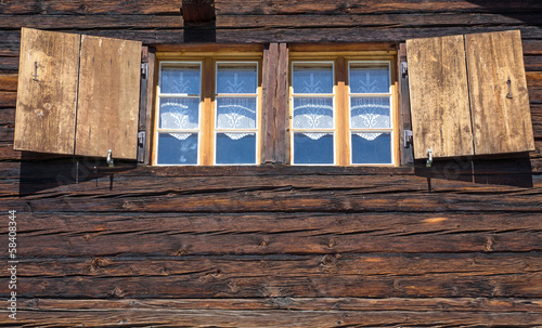 Two windows of a wooden hut