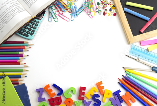 frame of colorful school supplies on white background