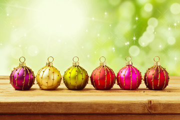 Christmas decoration on wooden table over bokeh background