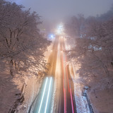 snowstorm, slick roads and lots of traffic in night city