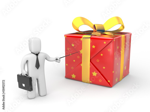 Businessman pointing to gift