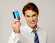 Cheerful businessman holding credit card