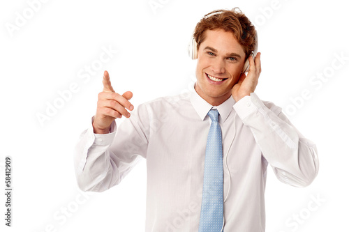 Guy enjoying music isolated over white