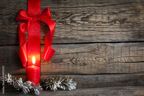 Christmas abstract background with red ribbon on vintage boards