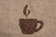 coffee beans shaping cup on burlap