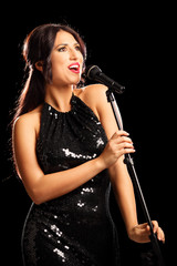 Glamorous young woman singing