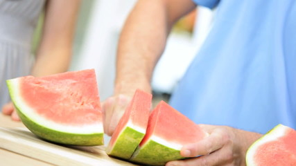 Hands Only Healthy Blonde Caucasian Male Slicing Watermelon Fruit