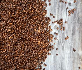 Fresh coffee grains on wood background
