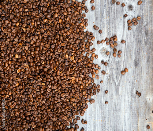 Fresh coffee grains on wood background
