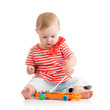 baby playing  with musical toys
