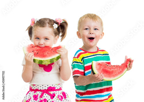 kids boy and girl eat watermelon isolated on white