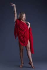 Sexy young model posing with red cloth