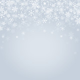 Falling snowflakes on grey background