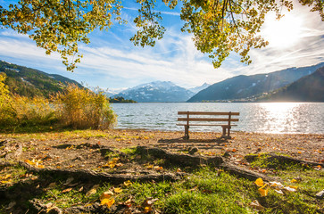 Beautiful autumn scene with bench at lake, Zell am See, Austria