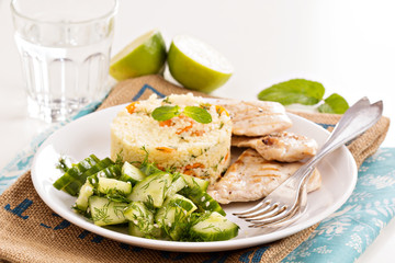 Grilled chicken with couscous and salad