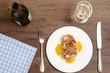 Gebratener Fisch mit Speck mit Weisswein