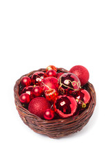 Red christmas balls in wicker basket