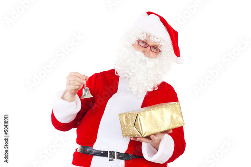 Santa Claus chimes the bell due to Christmas Eve
