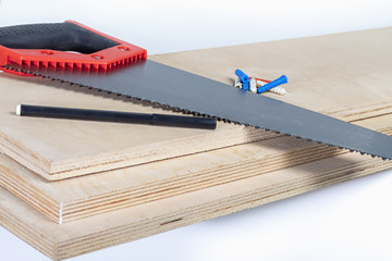 hacksaw on plywood boards with colored dowels