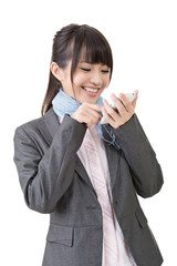 Asian business woman type on cell phone