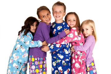 children hugging in holiday christmas pajamas