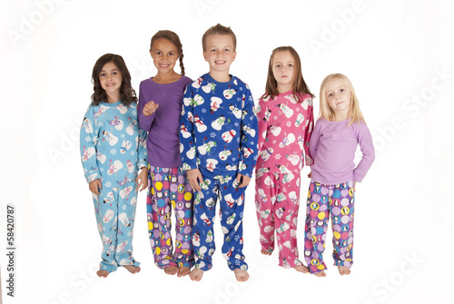 five young cousins wearing winter holdiday jammies