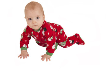 toddler boy crawling in fleece holiday pajamas