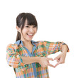 Smiling asian woman make heart shape