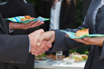 Business handshake during lunch
