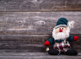 Santa Claus toy against wooden background - Christmas concept