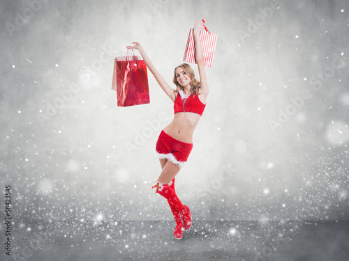 beautiful sexy girl wearing santa claus clothes snow flakes