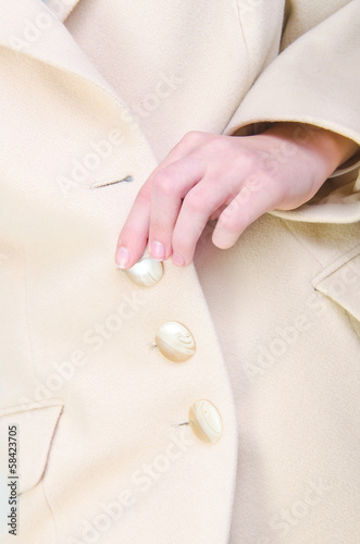 Close up  in suit buttoning button on Coat