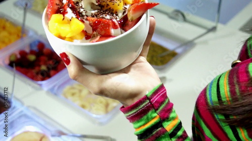 Woman serving frozen yogurt