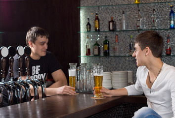 Barman chatting to a customer