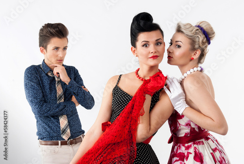 Girls in vintage dress gossip about aggravated gay