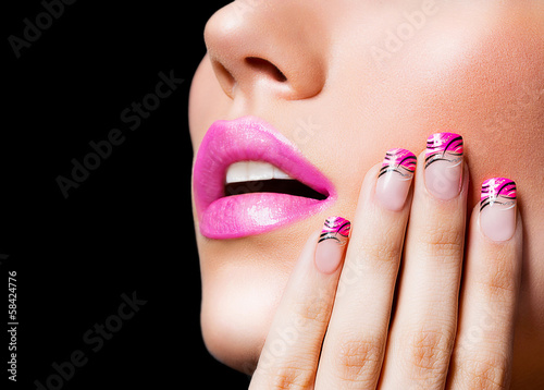 Beautiful girl with pink lips and nails