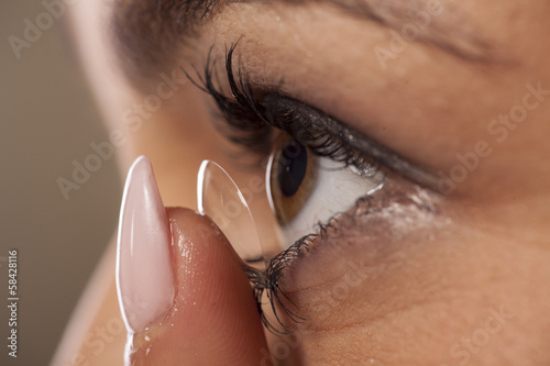 close-up view of the adjustment of contact lenses