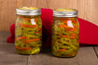 Hot pepper slices canned in mason jars