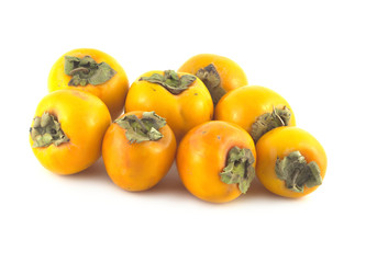 Ripe orange persimmons isolated on white close up