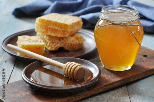 Honey in jar with honeycombs