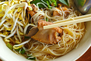 Pork noodles in soup asian style