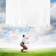 Businesswoman pulling blank banner