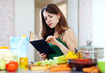 pensive  housewife  with cookbook