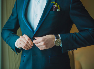 groom is preparing for a wedding celebration