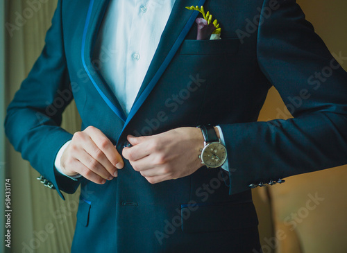 groom is preparing for a wedding celebration