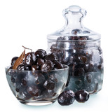 Dried black olives in a glass