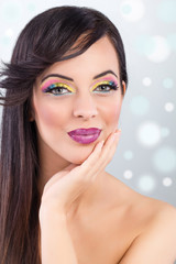 brunette model portrait. make up, false eyelashes