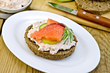 Sandwich with cream and salmon on an oval plate