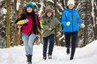 Active family - mother and kids running outdoor in winter park