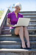 Gorgeous blonde businesswoman is working outside with her comput